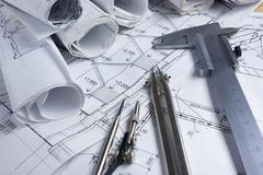 Architectural project, blueprints, blueprint rolls and divider compass, calipers - stock photo