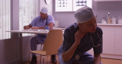 Two Doctors working long hours in the office Stock Footage