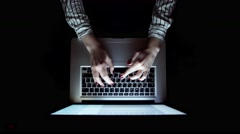 Man working with laptop, top view Stock Footage