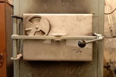 Old oven's door in old boiler room - stock photo