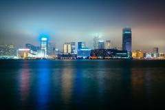 View of the skyline of Tsim Sha Tsui at night, seen from the Expo Promenade i Stock Photos