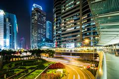 View of a traffic circle and skyscrapers at night, at Central, in Hong Kong,  Stock Photos
