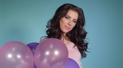 Slow motion of beautiful woman with balloons. Girl posing. Studio photo Stock Footage