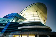The exterior of the Hong Kong Convention and Exhibition Centre at night, in H - stock photo