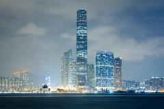 The Kowloon skyline at night, seen from Sheung Wan, in Hong Kong, Hong Kong. Stock Photos
