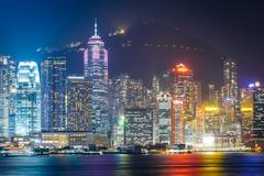The Hong Kong skyline and Victoria Peak at night, seen from Tsim Sha Tsui, in Stock Photos