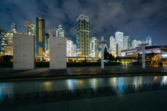Pool at Sun Yat Sen Memorial Park and modern skyscrapers at night in Hong Kon - stock photo