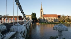 Traditional English church and a Suspension Bridge in Marlow, Engand Stock Footage