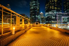 Modern skyscrapers at Tsim Sha Tsui at night, in Kowloon, Hong Kong. Stock Photos