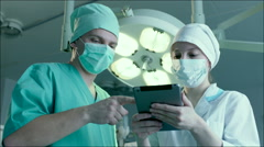 Nurse Writing Down Directions of a Doctor - stock footage