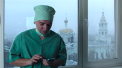 Doctor Talking on the Phone during the Break Stock Footage