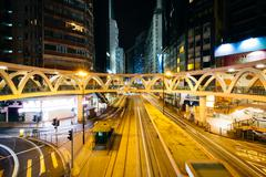 Long exposure of traffic on Yee Wo Street at night, at Causeway Bay, in Hong  - stock photo