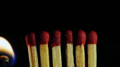 A number of matches ignited from one another - stock footage