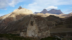 The ancient stone tomb in the background of rocky mountains. Timelapse - stock footage