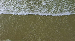 Overhead drone footage of sea waves reaching shore Stock Footage