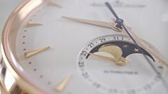 Luxury golden wrist watch with phase of the Moon indicator. Macro dolly shot Stock Footage