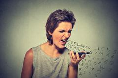 Portrait angry young woman screaming on mobile phone Stock Photos