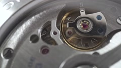Macro dolly shot of Swiss made wrist watch movement Stock Footage