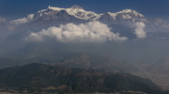 Timelapse of clouds form below the top of Annapurna South Stock Footage