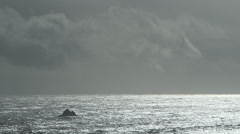 DRAMATIC OCEAN SCENE WITH SOLO ROCK AND NEGATIVE SPACE; ALTERNATE Stock Footage