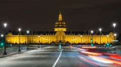 Traffic in fromt of the Les Invalides at night in Paris Stock Footage