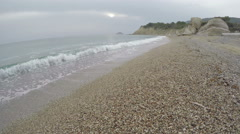 Waves on the pebbly beach on overcast day, Rhodes island, 4K Stock Footage