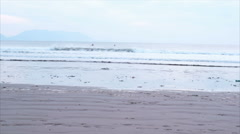 Slow motion of determined young woman jogging on beach. - stock footage
