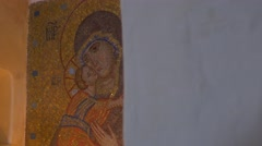 Old Saint Mary Icon Made of Golden Looking Mosaic With Lit Traditional Candles Stock Footage