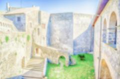 Defocused background of a Castle Inner Courtyard - stock photo