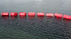Red buoy floats in the ocean sea Stock Footage