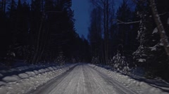 Travel through the forest winter night road Stock Footage