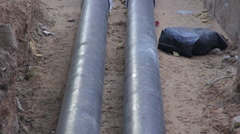 Central heating pipes going in the house Stock Footage
