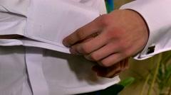 Hand man cufflinks businessman buttons cuffs sleeve Stock Footage