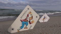 Two joker cards on the beach Stock Footage