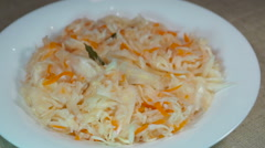 Sauerkraut with carrot, bay leaf and allspice Stock Footage
