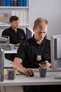 Stock Photo of Working at police station