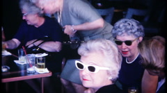 3157 senior women drinking whiskey & conversations - vintage film home movie Stock Footage
