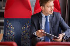 Stock Photo of Businessman using public transport