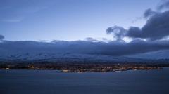 Time lapse of Icelandic city Akureyri at night Stock Footage