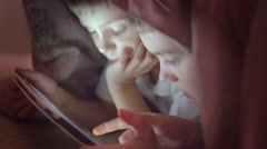 Brothers with tablet computer in a dark room Stock Footage