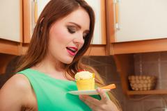 Woman holding delicious sweet cake. Gluttony. - stock photo