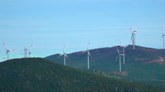 Wind energy turbines, renewable electric energy source. Raw of windmills on t Stock Footage