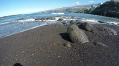 Waves on black sand beach with lava rocks, time lapse 4K Stock Footage