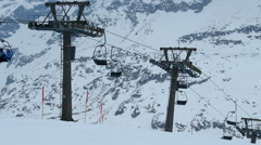Cableway lifting few tourists to skiing run, tourism crisis, abandoned resort Stock Footage
