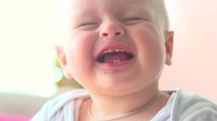 Cute little baby smiling and laughing closeup - stock footage