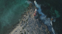 Aerial shot of lighthouse marina on coastline Stock Footage