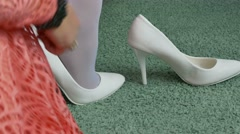 Bride shoes puts on his feet detail of wedding fees Stock Footage