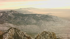 This is a timelapse shot looking down the mountain range during sunset of the Stock Footage