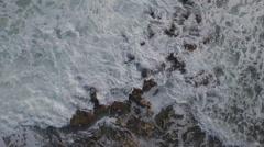 High angle shot of waves crashing on coast Stock Footage