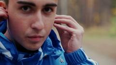 sports guy wears headphones - stock footage